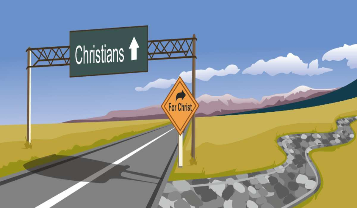 """a broad road with a sign overhead reading """"Christians"""" and then with a small turn off to the right reading """"for christ"""""""